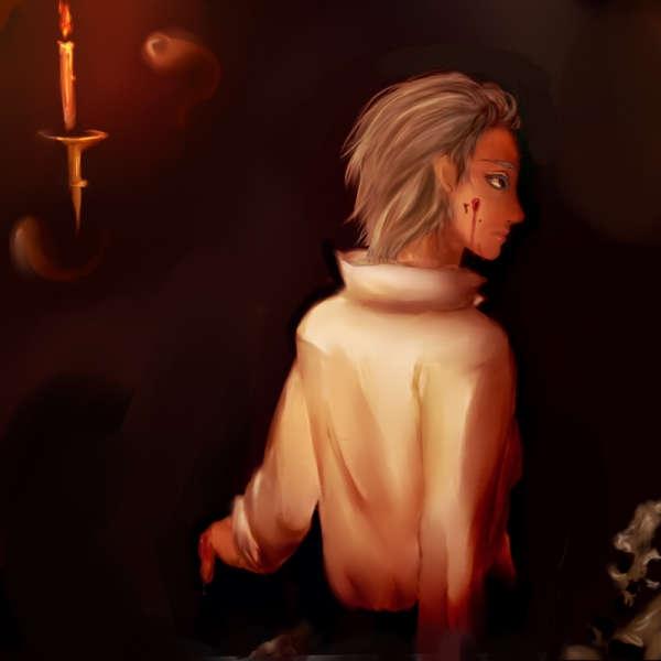 ろうそくに照らされた髑髏と中世的な人物
